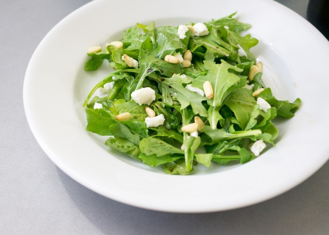 Top with toasted pine nuts and crumbled goat cheese